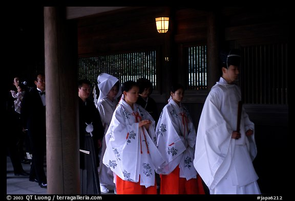Shinto priest leads traditional wedding at the Meiji-jingu Shrine. Tokyo, Japan (color)