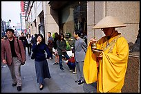 Buddhist monk seeking alms in front of a Ginza department store. Tokyo, Japan (color)