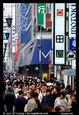 Crowds in the Ginza shopping district. Tokyo, Japan (color)