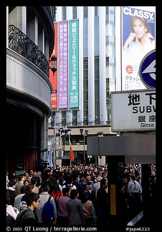 Crowds on the street near the Ginza subway station. Tokyo, Japan