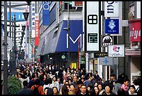 Crowded avenue in the Ginza shopping district. Tokyo, Japan (color)