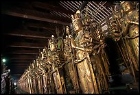 Rows of statues of the thousand-armed Kannon (buddhist goddess of mercy), Sanjusangen-do Temple. Kyoto, Japan