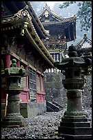 Urns, pavilion, and main hall in Tosho-gu Shrine. Nikko, Japan (color)