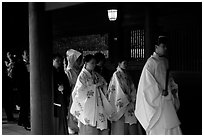 Shinto priest leads traditional wedding at the Meiji-jingu Shrine. Tokyo, Japan (black and white)