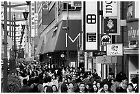 Crowded avenue in the Ginza shopping district. Tokyo, Japan (black and white)