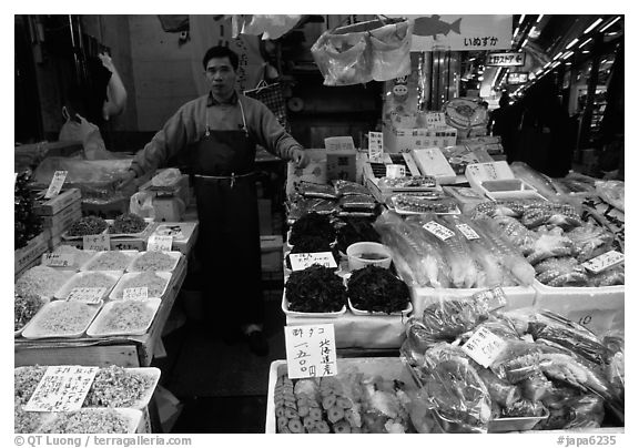 Seafood vendor in a popular street. Tokyo, Japan (black and white)