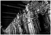 Rows of statues of the thousand-armed Kannon (buddhist goddess of mercy), Sanjusangen-do Temple. Kyoto, Japan (black and white)