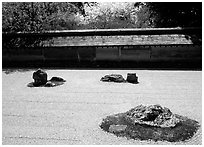 Classic stone and raked sand Zen garden, Ryoan-ji Temple. Kyoto, Japan (black and white)