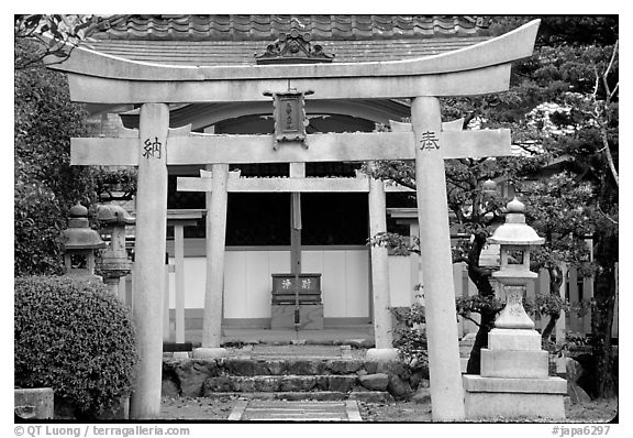 Tori gate at the entrance of a shrine inner grounds. The act of passing through purifies the soul.. Kyoto, Japan (black and white)