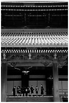 Uniformed schoolgirls visit Higashi Hongan-ji Temple. Kyoto, Japan (black and white)