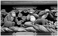 Three-monkey relief carving (hear no evil, see no evil, speak no evil) on Shinkyusha. Nikko, Japan (black and white)