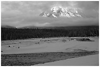 River, snow, and peak emerging from clouds. Banff National Park, Canadian Rockies, Alberta, Canada (black and white)