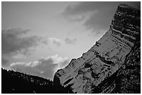 Sunrise and craggy mountain. Banff National Park, Canadian Rockies, Alberta, Canada ( black and white)