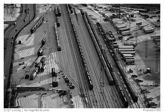 Rail tracks and cargo cars in winter. Calgary, Alberta, Canada (black and white)
