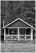 Cabin in the woods with interior lights. Banff National Park, Canadian Rockies, Alberta, Canada ( black and white)
