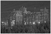 Banff Springs Hotel at dusk. Banff National Park, Canadian Rockies, Alberta, Canada ( black and white)