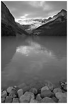 Boulders, Lake Louise, and Victoria Peak, sunrise. Banff National Park, Canadian Rockies, Alberta, Canada (black and white)
