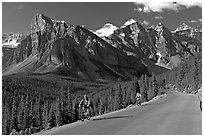 Cyclists on the road to the Valley of Ten Peaks. Banff National Park, Canadian Rockies, Alberta, Canada (black and white)