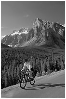 Cyclist on the road to the Valley of Ten Peaks. Banff National Park, Canadian Rockies, Alberta, Canada (black and white)