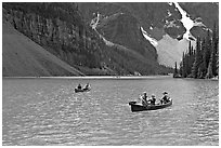Canoes on the robbin egg blue Moraine Lake, afternoon. Banff National Park, Canadian Rockies, Alberta, Canada ( black and white)