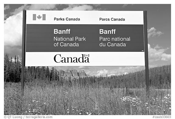 Bilingual sign at the entrance of the Park. Banff National Park, Canadian Rockies, Alberta, Canada (black and white)
