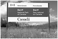 Bilingual sign at the entrance of the Park. Banff National Park, Canadian Rockies, Alberta, Canada ( black and white)