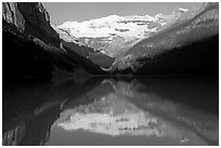 Victoria peak reflected in Lake Louise, early morning. Banff National Park, Canadian Rockies, Alberta, Canada (black and white)