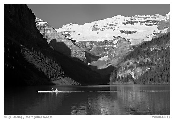 Rower, Lake Louise, and Victoria Peak, early morning. Banff National Park, Canadian Rockies, Alberta, Canada (black and white)