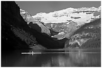 Rower, Lake Louise, and Victoria Peak, early morning. Banff National Park, Canadian Rockies, Alberta, Canada ( black and white)