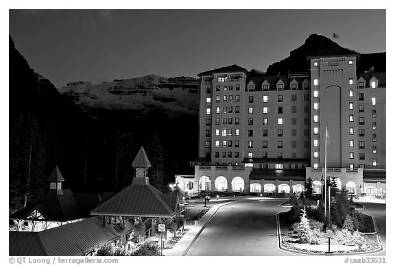 Chateau Lake Louise at night, with Victoria Peak looming behind. Banff National Park, Canadian Rockies, Alberta, Canada (black and white)