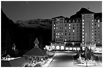 Chateau Lake Louise at night, with Victoria Peak looming behind. Banff National Park, Canadian Rockies, Alberta, Canada ( black and white)