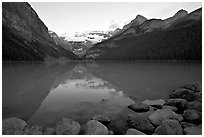 Boulders, Victoria Peak, and Lake Louise, sunrise. Banff National Park, Canadian Rockies, Alberta, Canada (black and white)