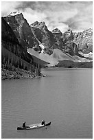 Canoeists below  Wenkchemna Peaks, Moraine Lake, mid-morning. Banff National Park, Canadian Rockies, Alberta, Canada (black and white)