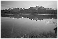 Bow range reflected in Herbert Lake, dawn. Banff National Park, Canadian Rockies, Alberta, Canada ( black and white)