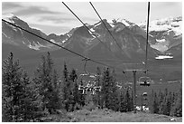 Riding a tram at Lake Louise ski resort. Banff National Park, Canadian Rockies, Alberta, Canada ( black and white)