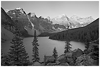 Wenkchemna Peaks above Moraine Lake, sunrise. Banff National Park, Canadian Rockies, Alberta, Canada (black and white)