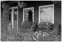 Porch of a cabin with flowers. Banff National Park, Canadian Rockies, Alberta, Canada (black and white)