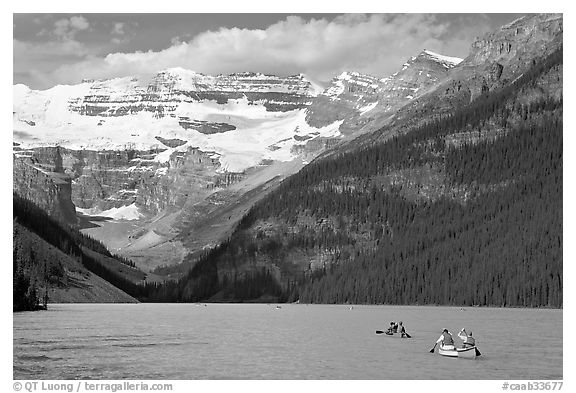 Canoes, Victoria Peak, and blue-green glacially colored Lake Louise, morning. Banff National Park, Canadian Rockies, Alberta, Canada (black and white)