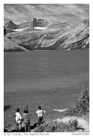 Family standing on the shores of Bow Lake. Banff National Park, Canadian Rockies, Alberta, Canada (black and white)