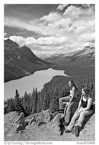 Women sitting on a rook overlooking Peyto Lake. Banff National Park, Canadian Rockies, Alberta, Canada (black and white)