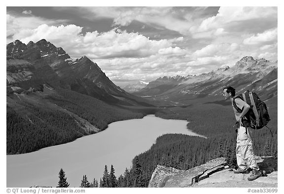 Hiker wearing backpack looking at Peyto Lake. Banff National Park, Canadian Rockies, Alberta, Canada (black and white)