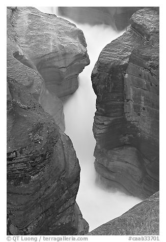 River flowing through narrow slot, Mistaya Canyon. Banff National Park, Canadian Rockies, Alberta, Canada (black and white)