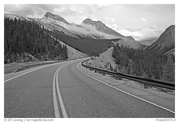 Twisting road, Icefields Parkway, sunset. Banff National Park, Canadian Rockies, Alberta, Canada (black and white)
