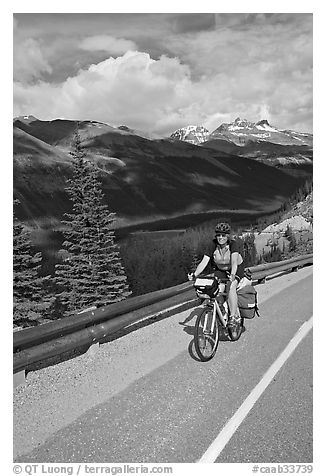 Woman cyclist, Icefieds Parkway. Jasper National Park, Canadian Rockies, Alberta, Canada (black and white)