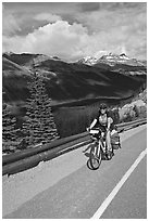Woman cyclist, Icefieds Parkway. Jasper National Park, Canadian Rockies, Alberta, Canada ( black and white)
