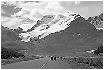 Cyclists on the Icefields Parkway at the base of Mt Athabasca. Jasper National Park, Canadian Rockies, Alberta, Canada ( black and white)