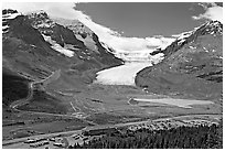 Icefields Center and Athabasca Glacier flowing from Columbia Icefields. Jasper National Park, Canadian Rockies, Alberta, Canada (black and white)