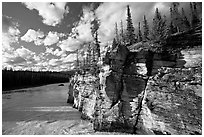Cliff and Athabasca River, late afternoon. Jasper National Park, Canadian Rockies, Alberta, Canada (black and white)
