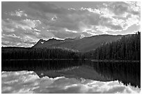 Peaks and clouds reflected in Leach Lake, sunset. Jasper National Park, Canadian Rockies, Alberta, Canada ( black and white)
