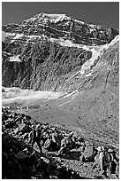 Hikers on trail below the face of Mt Edith Cavell. Jasper National Park, Canadian Rockies, Alberta, Canada ( black and white)